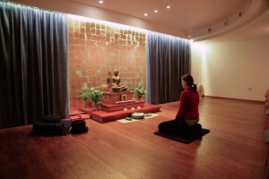 Meditating in the shrine room